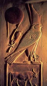 A crowned version of Horus as a Falcon. Below is the sign of Taurus, and you can see to the left is a Cross. At the top right you can see a large red ball, which may be a reference to Nibiru. - Armageddon Broadcast Network