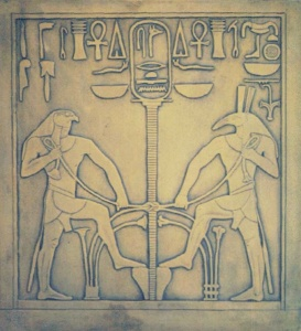 Egyptian Gods Seth and Horus around the sign of the union. Base of a seated statue of Pharaoh Sesostris I, (1971-1928 BCE). Sesostris' cartouche in top center. CGG 411, JE 31137 Egyptian Museum, Cairo, Egypt - Armageddon Broadcast Network